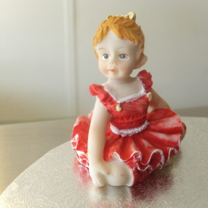 Red Dress Figurine